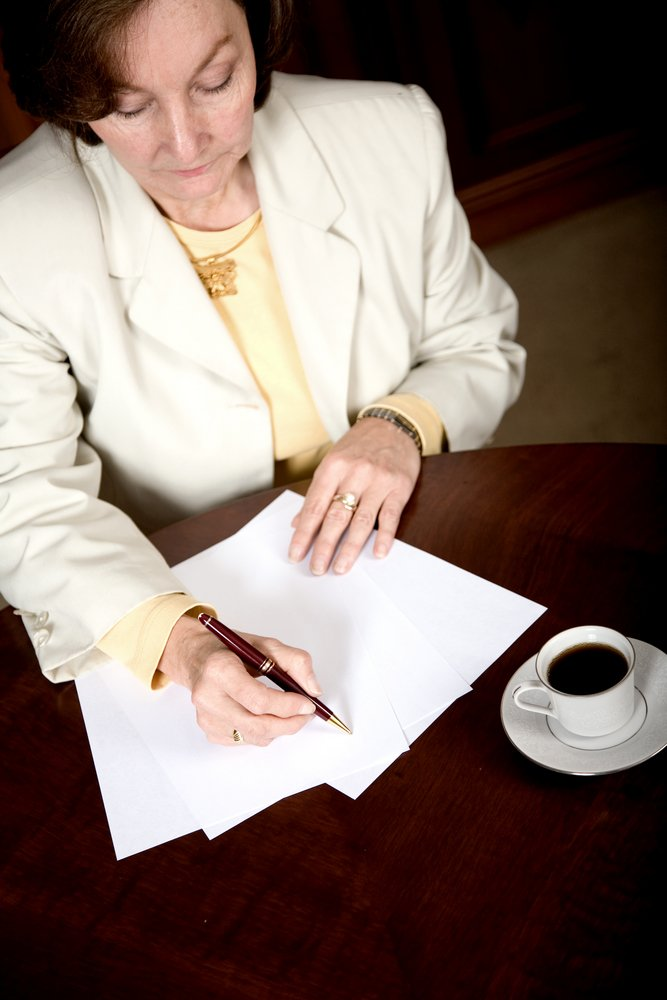 Business woman doing paperwork in her office